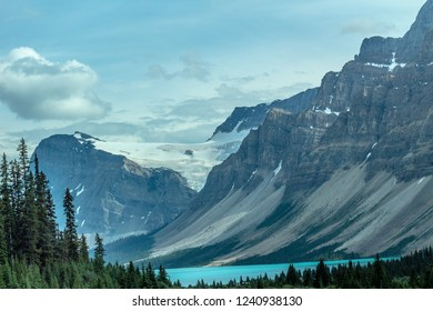 Blue glacial water and glacial mountains in the Canadian Rockies.