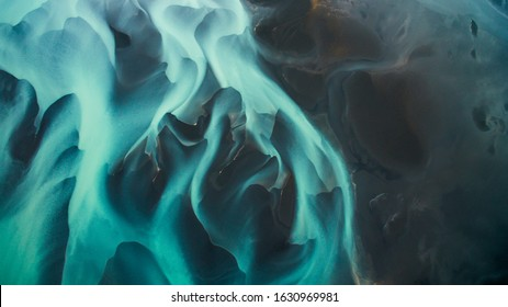 Blue glacier river in Iceland from an aerial perspective