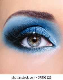 Blue glamour make-up of woman eye - macro shot