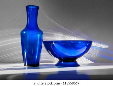 Blue Glass 1 - bowl and vase lit by sunlight