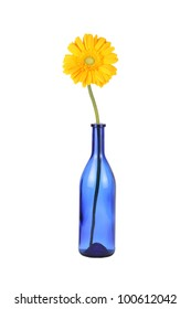 Blue glass bottle with daisy flower