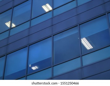 blue glass building window skyscraper corporation finance