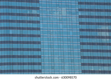 Blue Glass of Business tall buildings for design background.