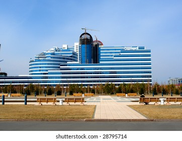 Blue glass house on a sky background