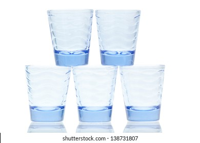 Blue glass stacked shot glasses on a white background