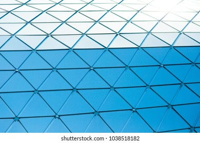 Blue glass wall ofconstruction and background.