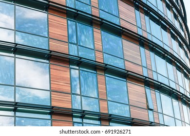 blue glass wall of office building with wooden decorative elements