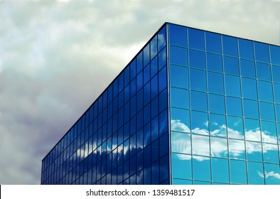 blue glass window office building corner sky