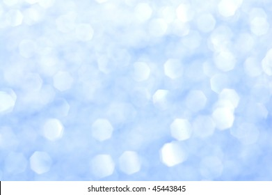 Blue glitter out of focus - abstract background