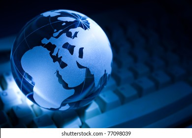 Blue Globe and Computer Keyboard for background