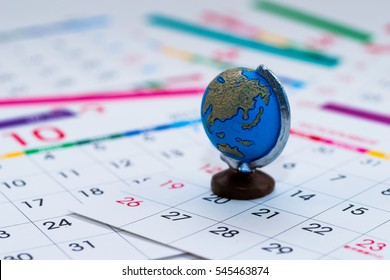 Blue globe on calendar