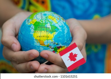 Blue globe with territories of the countries of the world and the Canadian flag, territory Canada