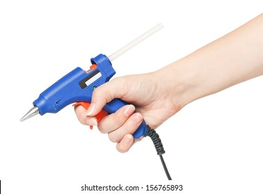 Blue glue gun in a woman hand isolated on white background