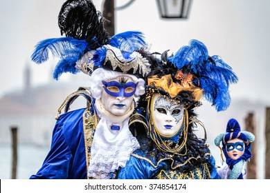 Blue and gold masked couple  with carnaval costumes, Venice, Italy.