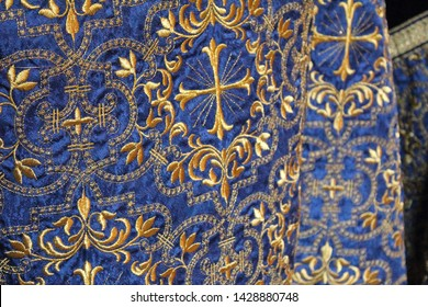 Blue and Gold Priestly Vestments with Crosses