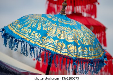 blue, gold and red Japanese umbrellas