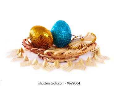 blue and golden  egg in basket isolated on white