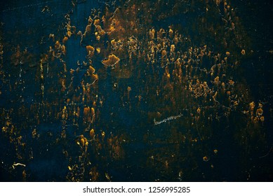 Blue golden vintage art background. Texture of decorative Venetian stucco. Sample. Gold magic book cover. Spotted scratched wall close-up. Backdrop of painted plaster in macro. Artwork textured plate.