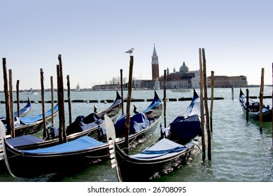 Blue gondolas and view over Venice