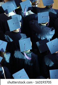 blue graduation caps from above