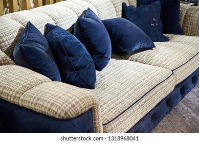 Blue and gray soft sofa upholstery velor in the room