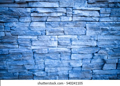 Blue and gray stone wall