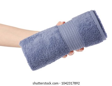 The blue gray towel roll in hand on white background isolation