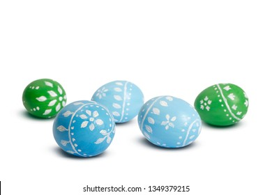 Blue and green easter eggs isolated on white background
