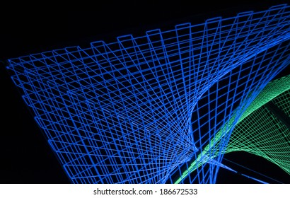 Blue and green lights created 3D formation in black background