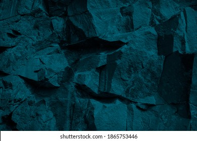 Blue green modern stone background. Monochrome toned rock texture background. Combination of dark teal color and rough rock texture.