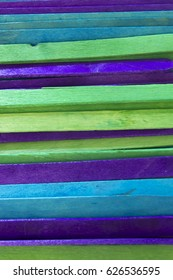 Blue, Green and Purple colored popsicle sticks background