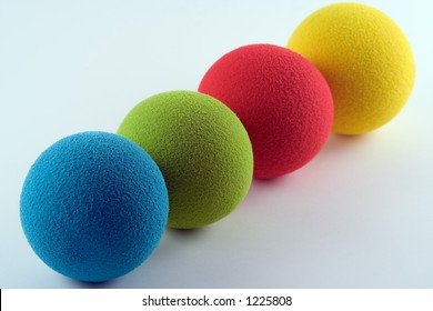 Blue, green, red and yellow sponge balls