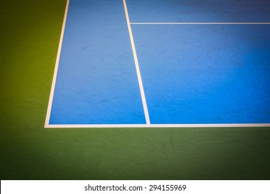 blue and green tennis court surface, sport background