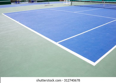 blue and green tennis court surface,Tennis ball on the field.
