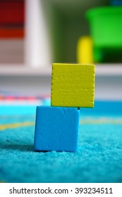 Blue and green wooden toy blocks
