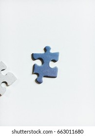 Blue and Grey Puzzle Pieces with Drop Shadow with Minimalistic White Background