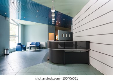 Blue and grey reception in a hallway of factory