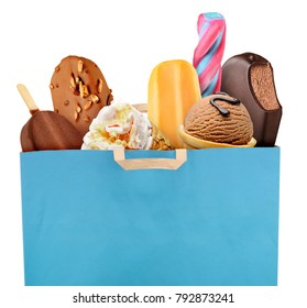 Blue grocery shopping bag full of ice cream and popsicle isolated on white background