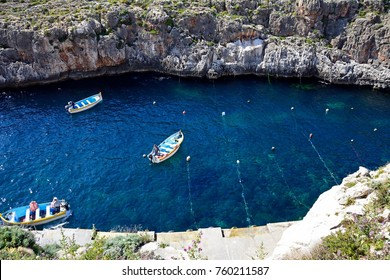 BLUE GROTTO, MALTA - APRIL 1, 2017 - Elevated view of traditional Dghajsa water taxi boats at the departure point in the bay, Blue Grotto, Malta, Europe, April 1, 2017.