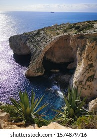 Blue grotto in Malta and bright blue water by it