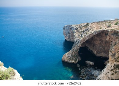 The Blue Grotto on the southeastern coast of Malta is famous for its eerie azure waters and is a popular spot for tourist boat rides