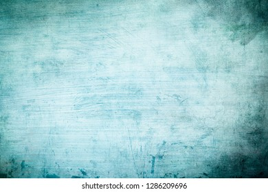 Blue grrungy wall background or texture