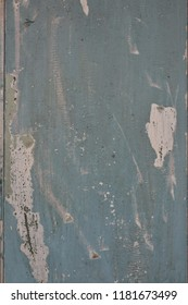 Blue grunge paint textured on wood for vintage background.