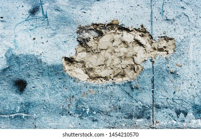 Blue grunge rough wall sealed hole inaccurately with cement
