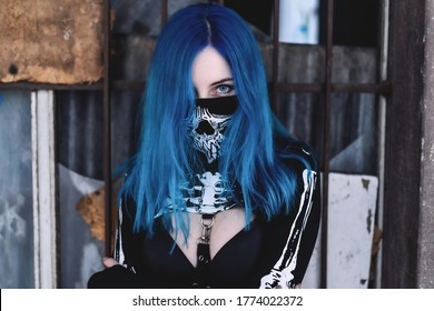 blue hair and blue eyes pale skin young girl model with cloth corona ( covid-19 ) mask street photography photoshoot