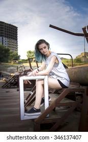 Blue haired girl walk on Old rusty forsaken barges