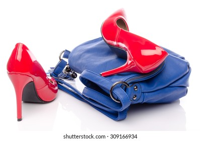 Blue handbag and red high heel shoes, isolated on white