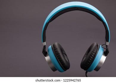 blue headphone on dark background isolated