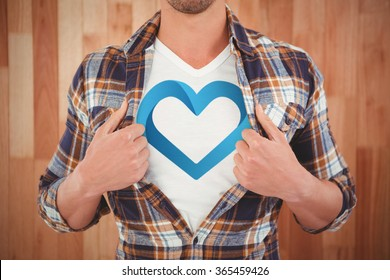 blue heart against mid section of hipster opening shirt in superhero style