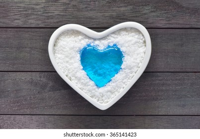 Blue heart crystal in white heart ceramic bowl